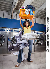 Woman Screaming While Carrying Overloaded Laundry Basket