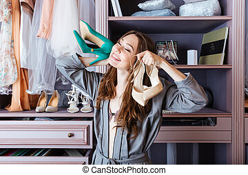 Woman searching for clothing in a closet