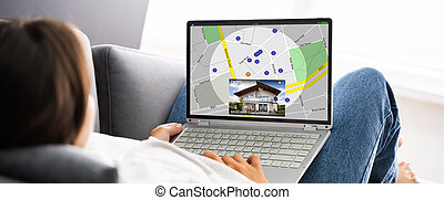 Woman Searching For Real Estate Online