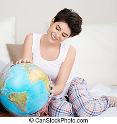 Woman Searching For Travel Destination On Globe