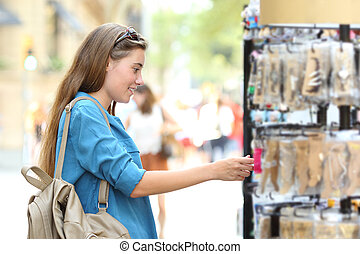 Woman searching products in a showcase