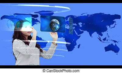 Woman searching through interactive media library on world...