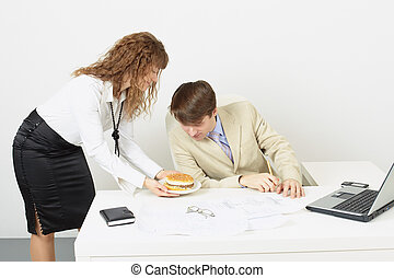 Woman secretary delivered to chief a sandwich