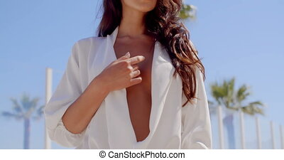 Woman Seductively Touching Cleavage on Beach