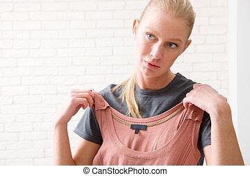 woman selecting a top