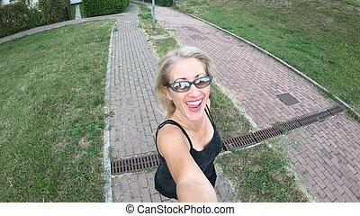 Woman selfie jogging