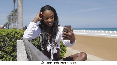 Woman selfies on bench in park - Cheerful young attractive...