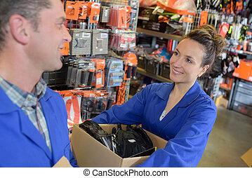 woman seller helping customer in warehouse