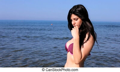 Woman sending kiss in the ocean