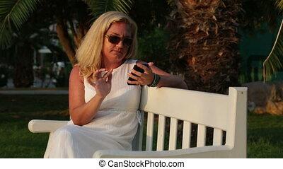 Woman sending text messages.