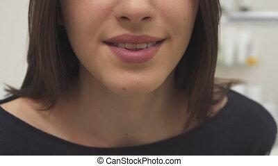 Woman sends air kiss