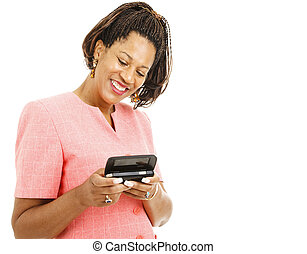 Woman Sends Text Message - Pretty african-american woman...