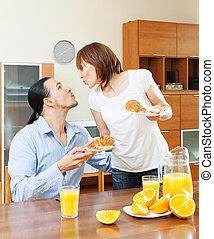 Woman serves breakfast her beloved man