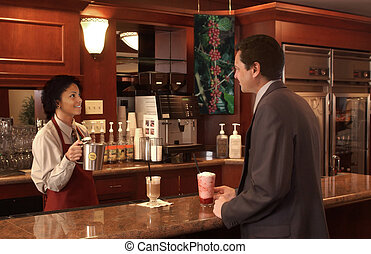 coffee shop - woman serving a businessman in a coffee shop