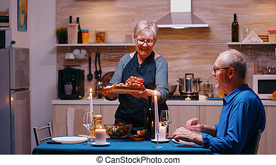 Woman serving husband