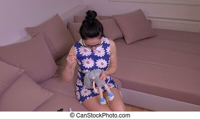 Woman sewing and try repairing old doll