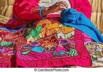 Woman sewing in Uros, Peru, Bolivia