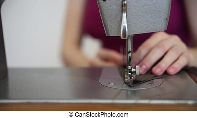 Woman Sewing On A Sewing Machine. Front view