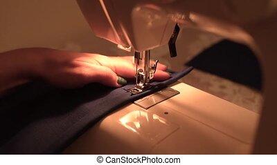 sewing machine - woman sewing on a sewing machine