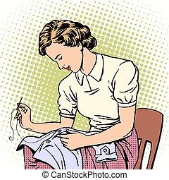 woman sews shirt thread housewife housework comfort