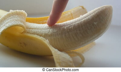 Woman sexually touching with a finger of purified banana,...