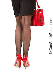 Woman sexy legs with handbag. Isolate on white. Shopping and business