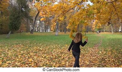 woman shake autumn tree