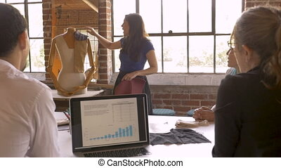 Woman sharing creative ideas during a presentation for...