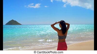 Woman shielding her eyes in the beach 4k - Woman shielding...