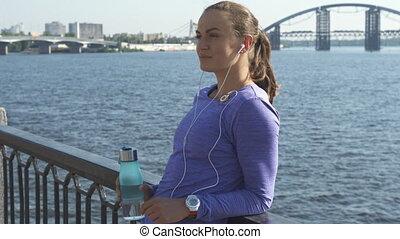 Woman shifts her gaze at the riverwalk