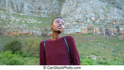 Woman shivering at countryside 4k - Young woman shivering at...