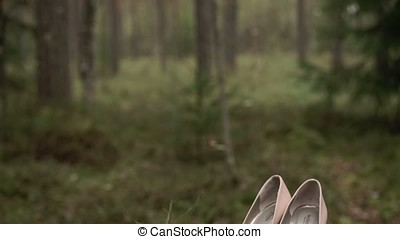 Woman shoes in forest