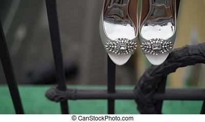 Woman shoes on balcony shot
