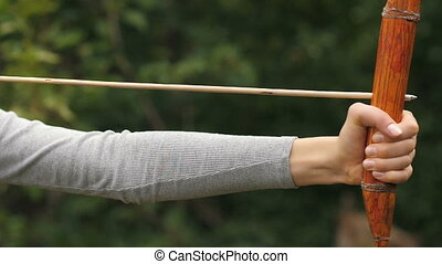 Woman shoots an arrow and satisfied of result - Athlete...