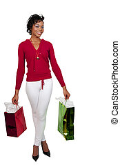Woman Shopping - A young black woman on a shopping spree