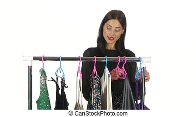 Woman shopping and buying fashion clothes. White