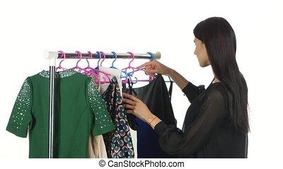 Woman shopping clothes. White