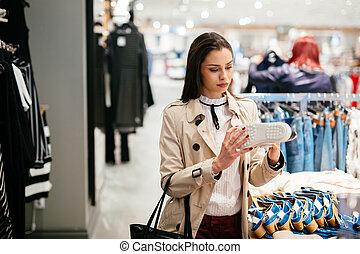 Woman shopping footware - Beautiful woman shopping trendy ...