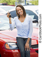 Woman shopping for a new car
