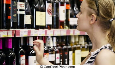 Woman shopping for alcohol in a bottle store