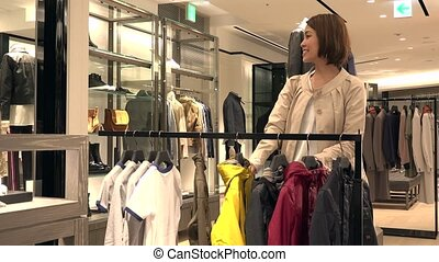 Woman Shopping For Child Jacket Mother Buying Clothes For Boy