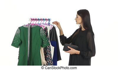Woman shopping for clothes. White