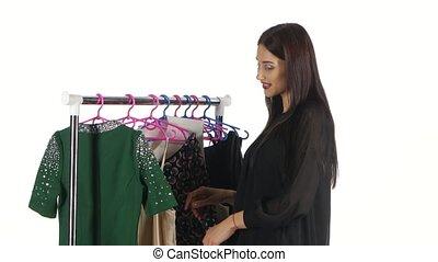 Woman shopping for dress. White