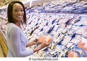 Woman shopping for fish