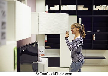 woman shopping for furniture and home decor - young hispanic...