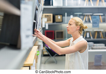 Woman shopping for furniture, sofa and home decor in store.