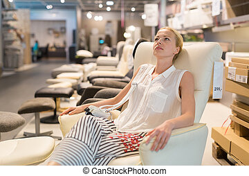 Woman shopping for furniture, sofa and home decor in store