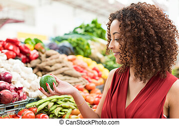 Woman shopping fruits - Afro woman shopping organic veggies...