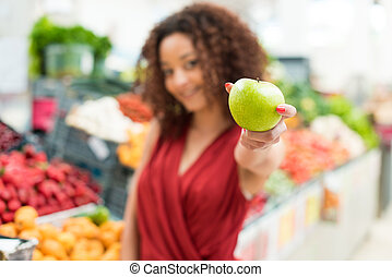 Woman shopping fruits - Afro woman shopping organic veggies...