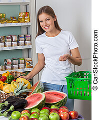Woman Shopping Fruits And Vegetables In Store